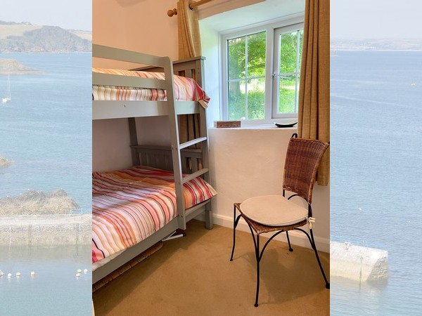 Separate additional shower room with a large quadrant shower enclosure.