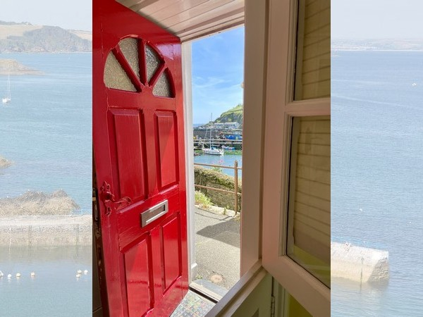 The stable door gives guests views over the harbour while they cook and eat!.