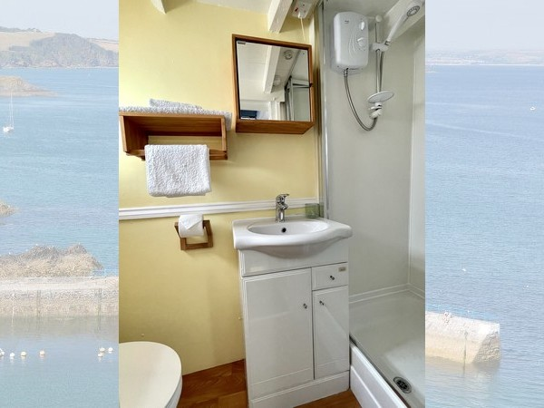 There is a small decked courtyard garden to the rear with table and chairs.