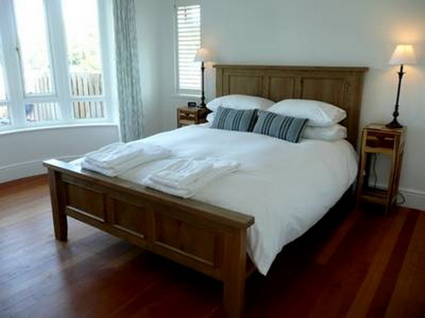 The master bedroom, with a kingsize bed, also has sea views.