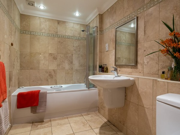 Second bedroom with two single beds, and luxury en-suite shower room.