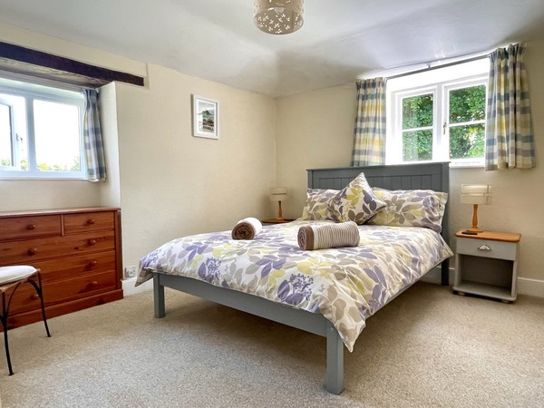 Double bedroom with en-suite, shower cubicle, wc, basin and heated towel rail.