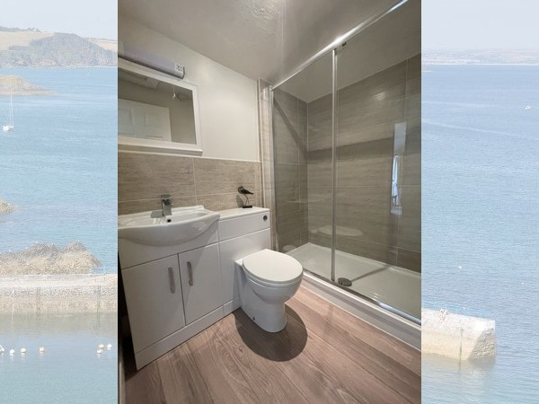 Sunny, private patio with table and seating enjoying valley and sea views.
