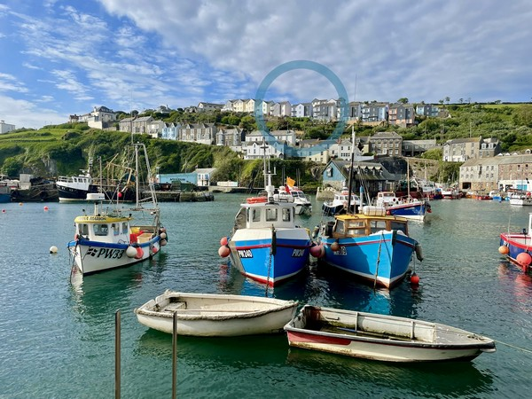 Trewollock, a large family house with stunning panoramic views over Mevagissey harbour.